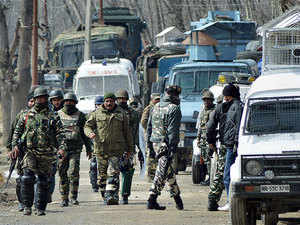 (Representative Image) Image shot on March 29 shows security personnel moving towards the house where two Lashkar-e-Toiba (LeT) militants were hiding during an encounter at Padgampora village of Awantipora in Pulwama district.