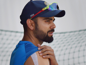 Virat Kohli strapped right shoulder during a practice session ahead of the last test match against Australia at HPCA Stadium in Dharamsala.