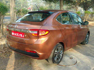 Tigor boasts of features like LED Tail Lamp, projector headlamp, dual tone interiors, touchscreen Infotainment system, multi drive mode, fully automated climate control