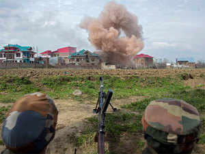 Smoke blowing out after security forces blasted a house to eliminate a holed up militant during an encounter at village Durbugh in Chadoora area of central Kashmir's Budgam district on Tuesday