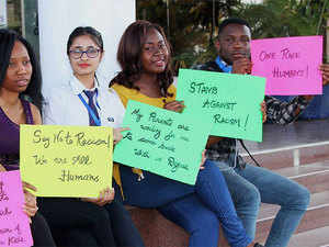 Foreign students protest in Jalandhar on Wednesday over the recent attacks on African nationals in Greater Noida.