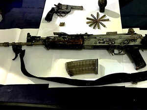 An INSAS rifle, a pistol, a hand grenade and bullets were seized from them, the officer said.