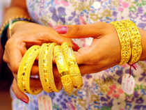 Gold and silver futures on the Multi Commodity Exchange were trading lower on Friday on account of subdued demand of precious metals.