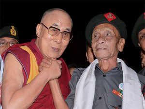 Tibetan spiritual leader Dalai Lama with Naren Chandra Das, a retired havildar of 5 Assam Rifles during Namami Brahmaputra festival in Guwahati on Sunday.