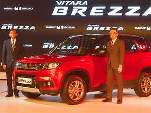 Suzuki Motor Corp. President Toshihiro Suzuki, right, and Maruti Suzuki India Managing Director and CEO Kenichi Ayukawa during the world launch of Vitara Brezza.