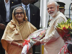 Prime Minister Narendra Modi receives his Bangladeshi counterpart Sheikh Hasina on her arrival at IGI Airport in New Delhi on Friday for a four-day visit to India.