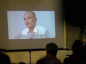 In this photograph taken on March 29, 2016, Pakistani journalists watch a video showing Indian national Kulbhushan Yadav, arrested on suspicion of spying, during a press conference in Islamabad.