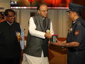 Defence Minister Shri Arun Jaitley handing over 'E-Nasika' to DG – NDRF Shri RK Pachnanda at Metcalf House.