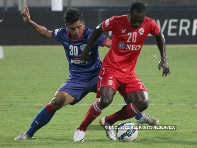 Malsawmzula of BFC in action against Alfred Kemah Jaryan of AFC in the Federation Cup football played at Kanteerava stadium in Bengaluru.