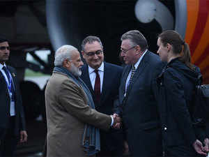 PM Narendra Modi being greeted by Russian officials after arriving in St Petersburg.  Image: PM Narendra Modi's Twitter handle.