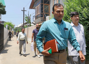 NIA officials after conducting raids in conection with terror funding recevied from Pakistan, in Srinagar.