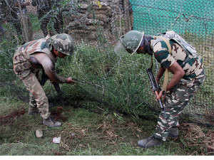 Security personnel inspecting the spot where four Suicide attackers were killed during their attack on CRPF camp, at Sumbal in Bandipora district of north Kashmir.
