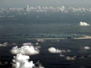 An aerial photo taken though a glass window of a Philippine military plane shows the alleged on-going land reclamation by China on Mischief Reef in the Spratly Islands in the South China Sea, west of Palawan, Philippines.