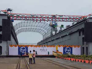 The Floating Dock, which is the first Naval shipbuilding project for L&T, is 185m long and 40m wide, and is designed  for docking Indian Naval ships and submarines of up to 8000 T displacement with draughts of up to 7 m, during both day and night