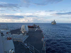 Arleigh Burke-class guided-missile destroyer USS Dewey (L) preparing for a replenishment-at-sea with the Henry J. Kaiser-class fleet replenishment oiler USNS Pecos (R) in the South China Sea.