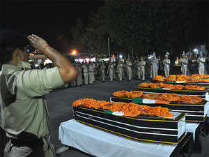 Security personnel paying tribute to martyred CRPF jawans at Patna airport. 25 CRPF jawans were killed in a Naxal attack in Chhattisgarh's Sukma district.