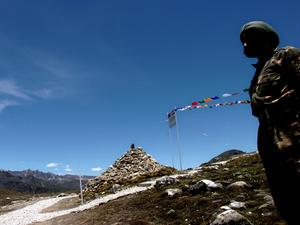 An Indian soldier, gurading Indian post at Indo - China border area in Bumla, Arunachal Pradesh.