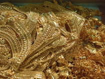Gold edged lower on Monday as investors shunned safe-haven assets for equities.