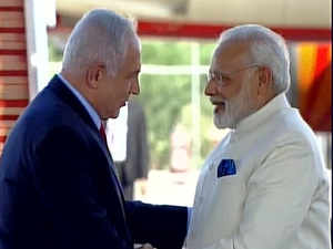 PM Narendra Modi and Israeli PM Benjamin Netanyahu greeting each-others at the Ben Gurion Airport in Israel today.