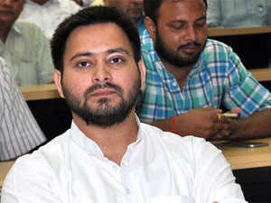 The name plaque of RJD leader Tejashwi Yadav was first covered with a piece of cloth and soon removed from the dais.