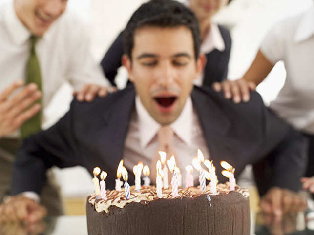 Bioaerosols in human breath may be a source of bacteria transferred to the cake surface.