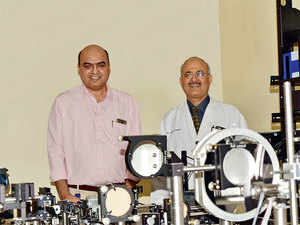 Richhariya (L) worked on an Adaptive Optics Scanning Laser Ophthalmoscope which can image individual cells of the retina. To his right is ophthalmologist Sangwan