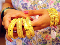 Gold and silver were trading in red in morning trade on Thursday on account of subdued demand of precious metals by jewellers, investors and industrials amid weak global cues.