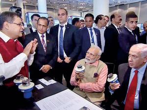 Anjan Mukherjee presenting product before PMs of India & Israel