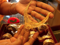 Gold prices on Thursday drifted further away from seven-week highs hit earlier this week, as the dollar firmed on expectations the US Federal Reserve could trim its bond holdings in September.