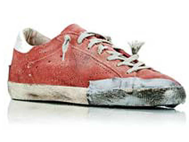 A shoe brand came under fire for selling distressed sneakers — with duct tape and holes — for $500 to $600.  (Image: www.barneys.com)