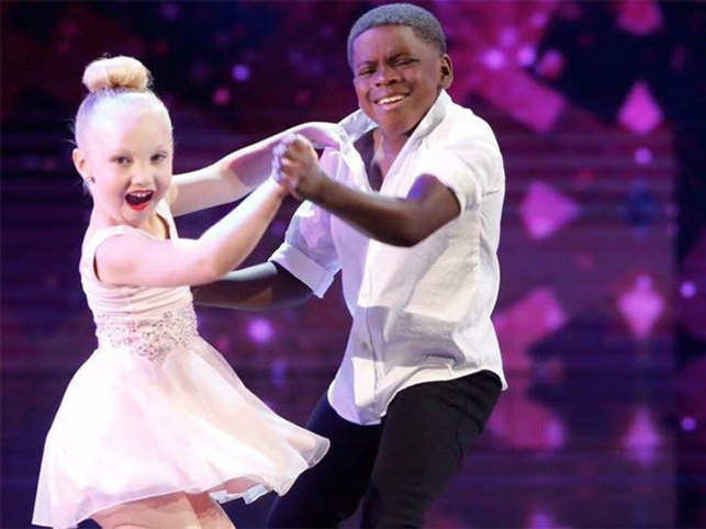 Eight-year-old Artyon and nine-year-old Paige during their performance.