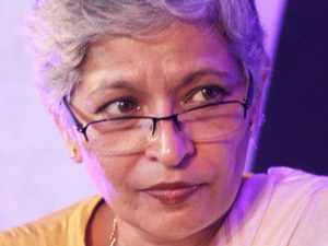 """A long line of mourners led by the CM paid respects to Lankesh at her funeral, amid sloganeering of """"I am Gauri"""" and """"come back to us again."""""""