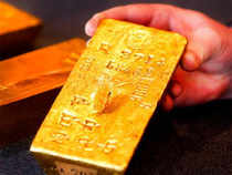 Profit booking in precious metals dragged gold prices down from its 1-year high levels in early trade on Monday.