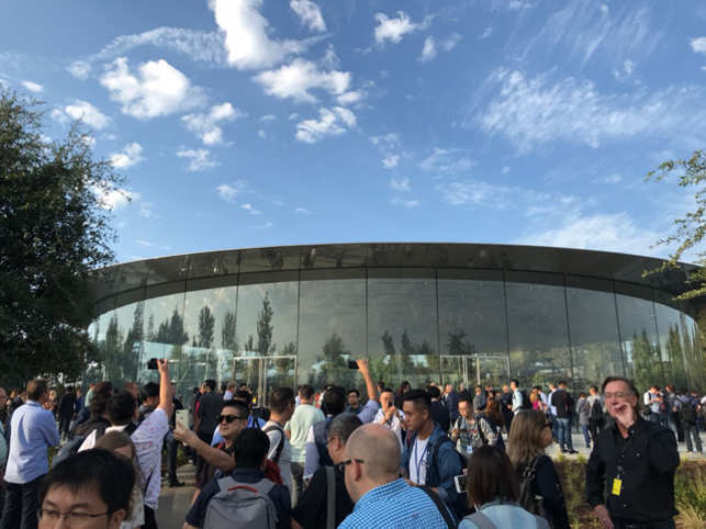 This is the Steve Jobs Theatre where media professional from around the world have gathered for Apple's mega event.