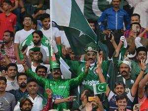 Pakistani spectators cheer at the start of the first Twenty20 international match between the World XI and Pakistan at the Gaddafi Cricket Stadium in Lahore.