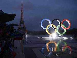 A picture shows the Olympics Rings on the Trocadero Esplanade near the Eiffel Tower in Paris.