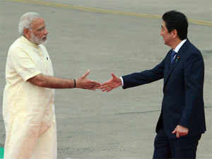 Prime Minister of Japan Shinzo Abe walks with Prime Minister Narendra Modi at a welcome ceremony at Ahmedabad airport in Gujarat.