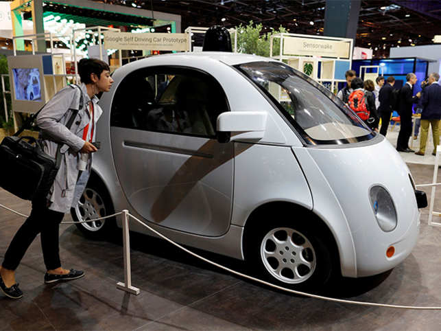 A visitor looks at a self-driving car by Google at the Viva Technology event in Paris, France.