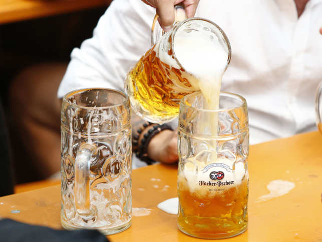 The beer began to flow from the first barrel after its tap was struck twice with a mallet by Munich Mayor Dieter Reiter.