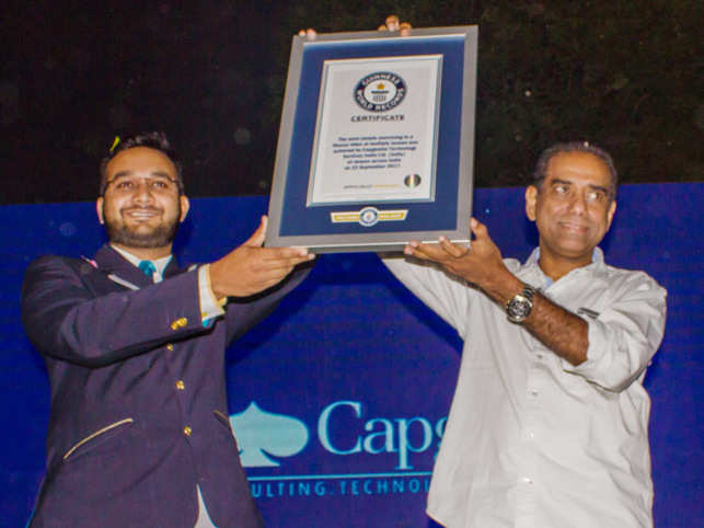 Srinivas Kandula, Country Head-India, Capgemini, receives the certificate from Swapnil Dangarikar (left), official adjudicator, Guinness World Records.