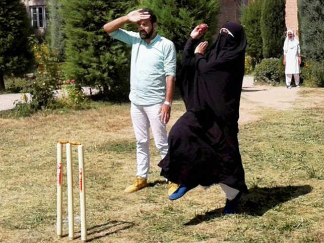 Woman cricketer in burqa.