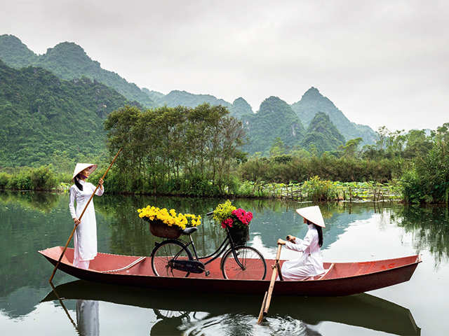 A lazy river, mustard-yellow houses, and sprawling beaches, Hoi An is a traveller's dream come true