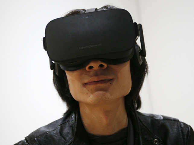"""Unlike its predecessor """"Oculus Rift"""", this VR headset will not require plugging into a smartphone or a personal computer to function. (In Pic: Man wearing Oculus Rift)"""