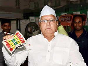 """""""He is a fake socialist. Real socialist neither joins hands with communal forces nor is afraid of them,"""" Lalu Prasad tweeted."""