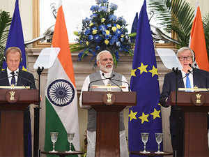 PM Narendra Modi (C) stands next President of the European Council Donald Tusk (L) and European Commission President Jean-Claude Juncker.