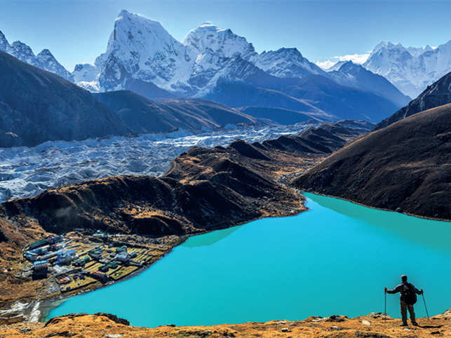 During your Himalayan trek to Sagarmatha, take the trail of Gokyo Ri (5,357 m). Here, enjoy the serene view of the Himalaya mountains (Cholatse and Taboche to the left), Ngozumpa Glacier and Gokyo lakes (the world's highest freshwater lakes) near the village of Gokyo in Sagarmatha National Park. This UNESCO World Heritage Site in Khumbu region of Eastern Nepal sees scores of trekkers including many Indians each year.