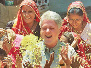 Bill Clinton dancing with women of Nayla in March 2000.