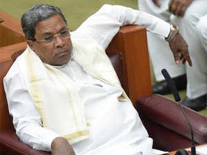 Gowda submitted that the CM  Siddaramaiah (in pic) had abused his official position as a public servant by corrupt or illegal means without any public interest and dishonestly approved the renewal of mining lease or mining licence to the other accused persons.