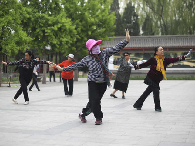 China asks elderly women performers to dance away from cemeteries
