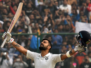 Virat Kohli raises his bat after scoring double century (200 runs) during the 2nd day of the third Test cricket match between India and Sri Lanka at the Feroz Shah Kotla Cricket Stadium.